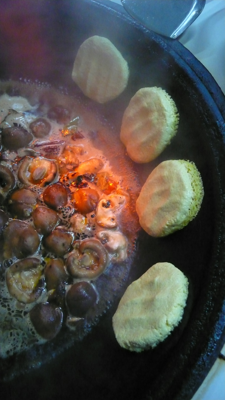 hot pot with corn meal cakes
